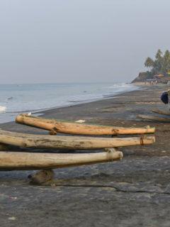 Varkkala split log canoes on the beach