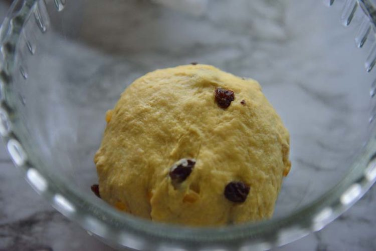 Dough for hot cross buns in a bowl before rising.
