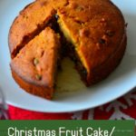 Christmas fruit cake on a white platter with caption - image for pinning