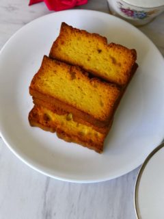 round plate with rectangular rusk piled on it.