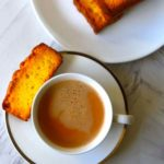Image for pinning - Coffee in a cup with rusk on the saucer and a plate with more rusk on it.