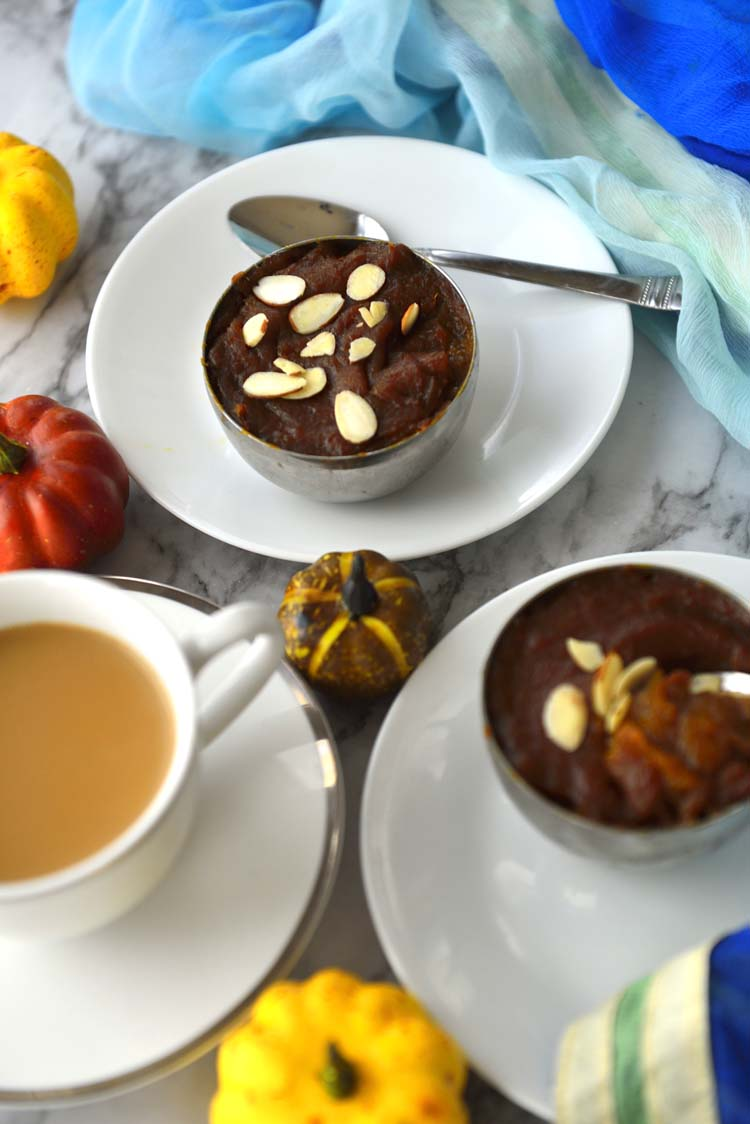 Two bowls of Pumpkin halva in small bowls and a cup of tea