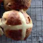 "Hot Cross buns on a cooling rack. Image with caption ""Light and healthy hot cross Buns"""