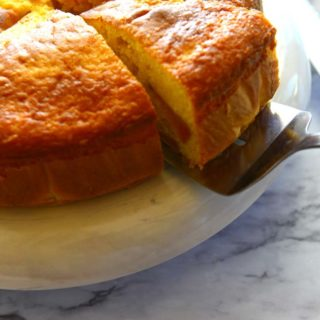 A slice of fresh peach coffee cake made with boxed mix