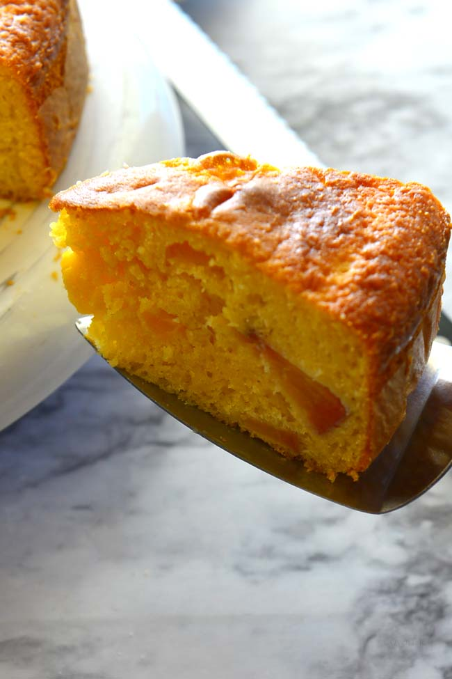 Slice of fresh Peach cake made with boxed cake mix