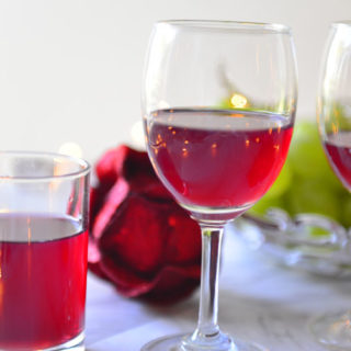 Glasses with red wine on a festive table.