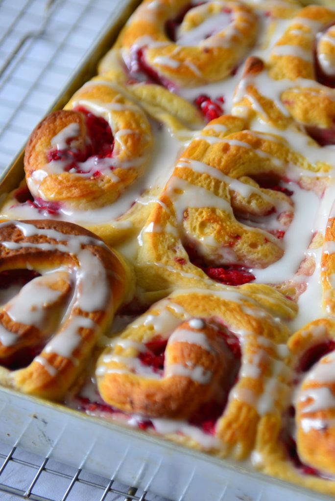 Closeup of Raspberry Swirl Sweet Rolls in a baking pan