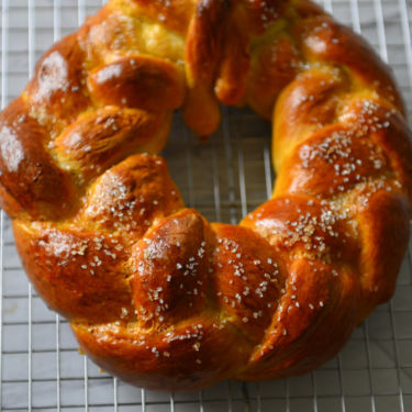 A Finnish Pulla wreath resting on the cooling rack