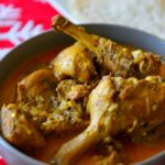 Duck curry in a serving bowl with caption. Image for Pinning