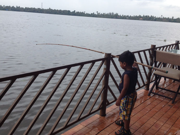 Fishing from the porch in Kuttanad