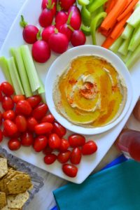 Home made hummus served with fresh veggies and crackers for snacking