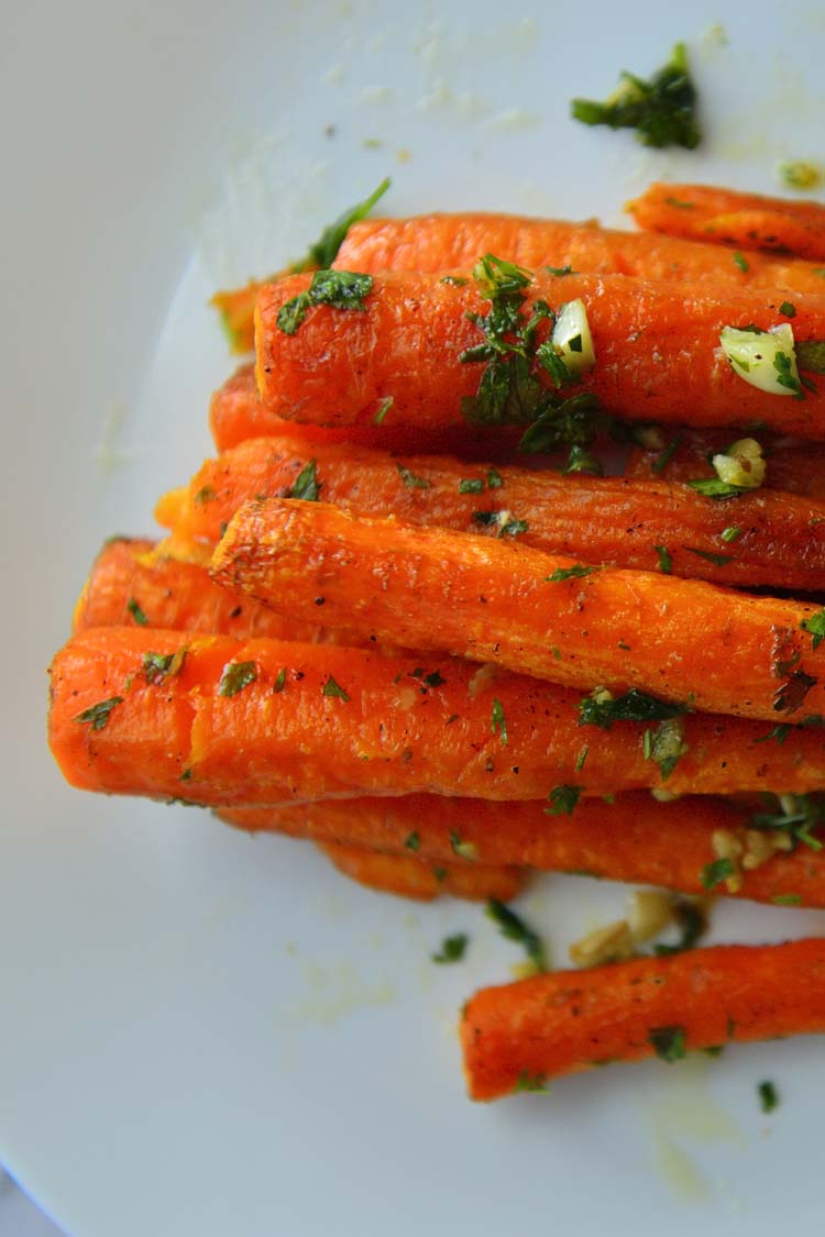 Roast Carrots on a white background