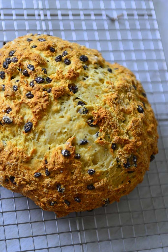 A loaf of Irish Soda bread resting on a cooling rack