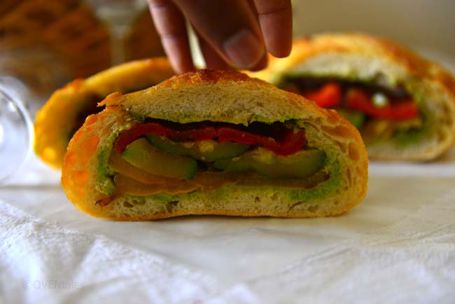 A delicious  pressed  sandwich with  grilled  vegetables  and  a crusty loaf