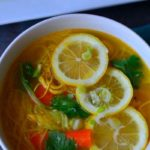 "A bowl of soup with caption "" Spicy Chicken Noodle Soup, Chicken- thukpa"" . Image for pinning"