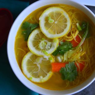 Spicy chicken Noodle Soup in a bowlby Tibetan Thupka