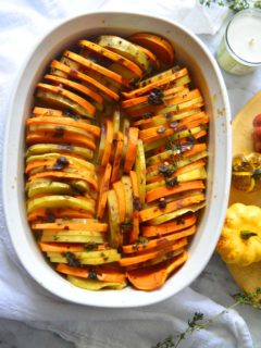 Savory Sweet Potato Casserole in a white casserole, placed on a serving table.