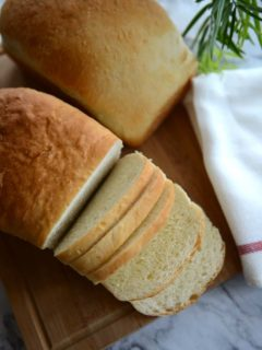 Herman Milk Bread Loaves- One Sliced to show texture.