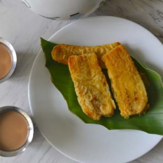 Pazham Pori or Ripe Plantain Fritters served with hot cardamom chai