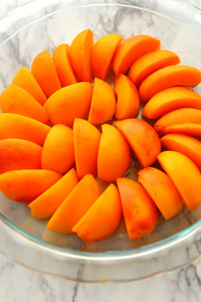 Sliced Apricots arranged in the pie dish for making Apricot Clafoutis