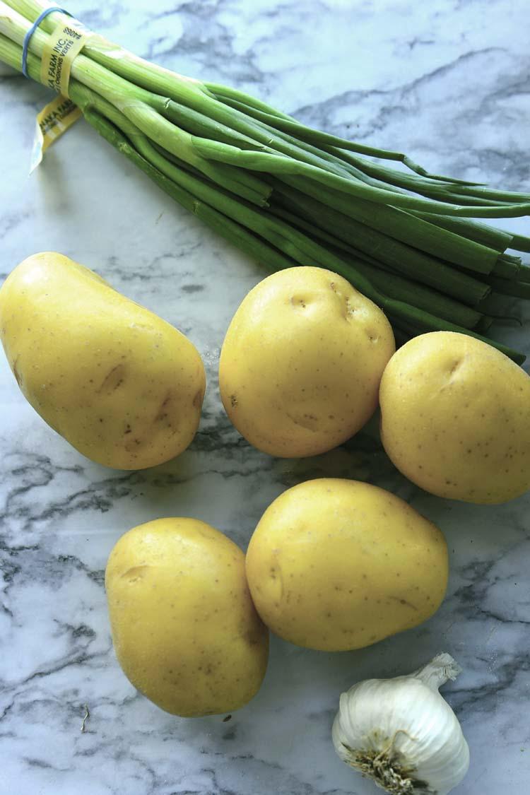 Potatoe, scallions and a head of garlic