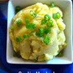 Mashed potatoes in a white bowl along with caption - Garlic Mashed Potatoes | Vegan