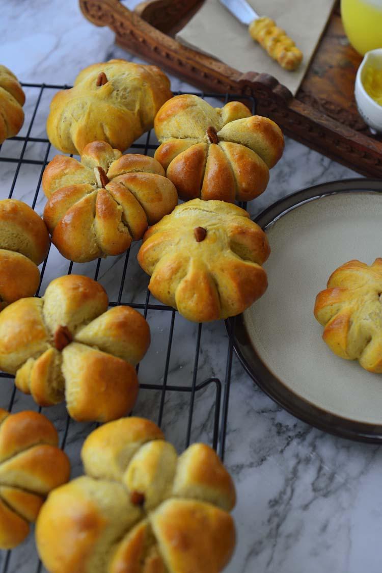 An assortment of pumpkin shaped rolls - varying sizes to uniform rolls