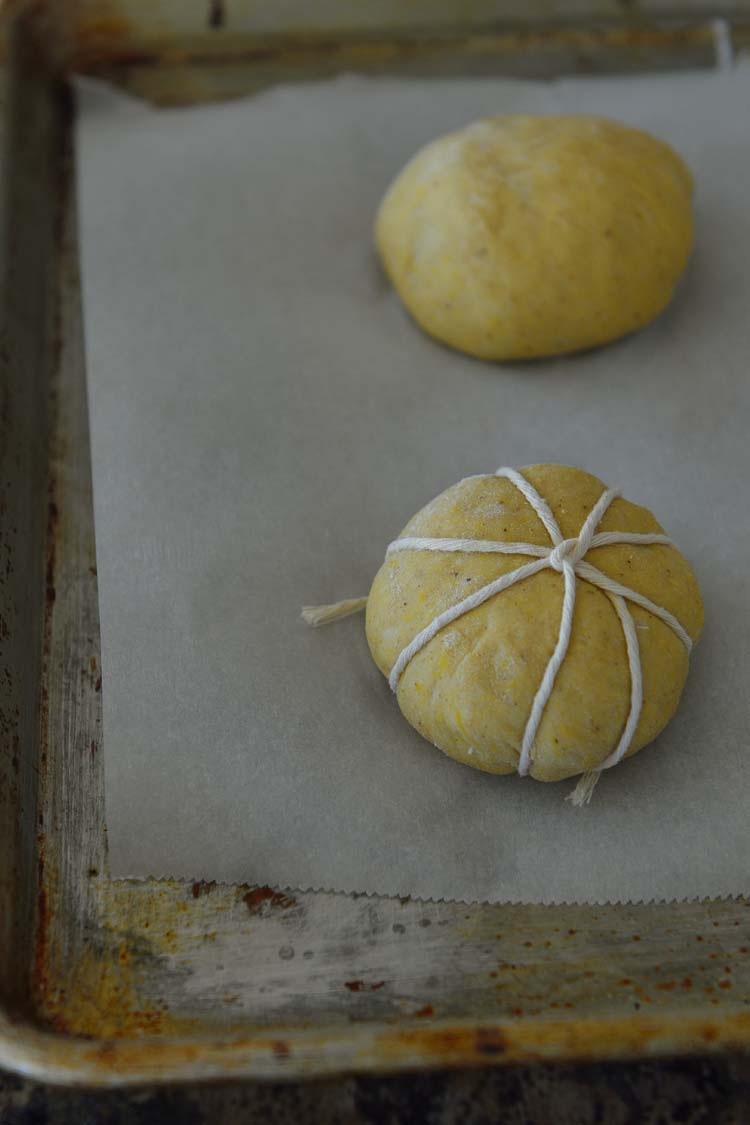 Dough ball with string around it diving into 8 equal section