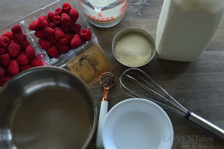 Ingredients for Lavender Panna Cotta - Raspberry, lavender, Milk, Cream, Gelatin, sugar bowl with water, pan and a whish