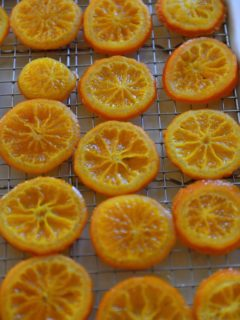 Candied orange slices on the cooling rack.