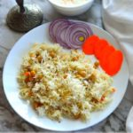 Garbanzo beans pilaf on a plate with a bowl of raita. Image with caption ' Chickpea Pilaf - Instant Pot version'. Image for Pinning