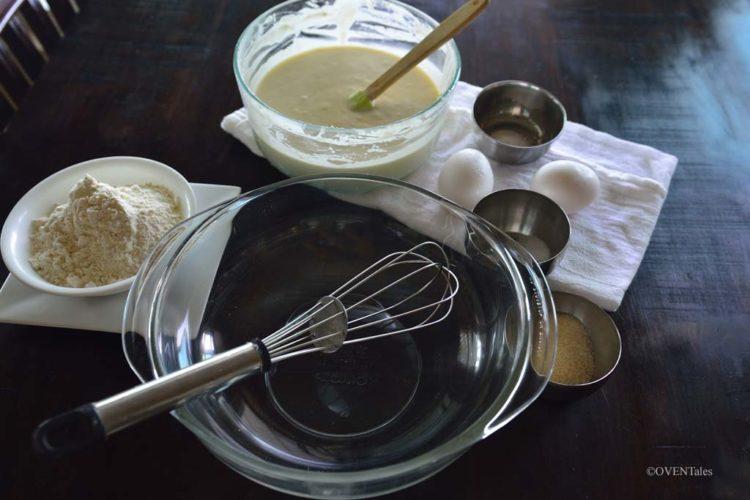 Preparing to make Herman pancakes, ingredients set up on table.
