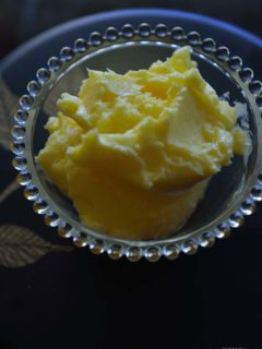 Bowl of butter on dark background